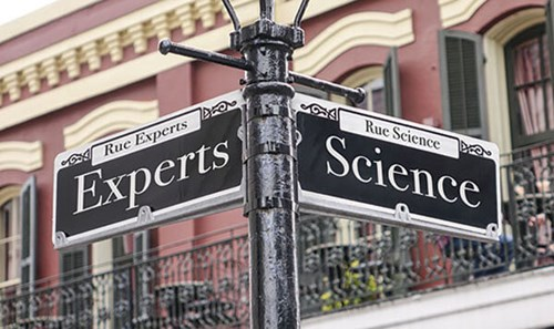 Street Sign, experts one direction, science in the other