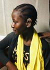 Mariama being fitted with hearing aids