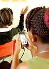 Photo showing smartphone hearing screening in pre-schools facilitated by trained lay health workers.