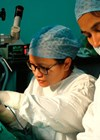 Photo showing Urmila Gurung undertaking ear surgery